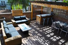 Chicago roof deck built garage roof deck with cedar pergola, concrete firepit and built in bar.