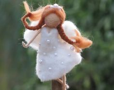 MADE TO ORDER  Angel Christmas tree topper decorated with stars. Needle felted from merino wool and silk fiber. Waldorf inspired doll. There are more tree toppers angels and fairies in my shop. Thank you for visiting my shop!!  Please see my shop policies for more information: http://www.etsy.com/shop/Made4ubymagic/policy  Angel Christmas tree topper decorated with stars. Needle felted from merino wool and silk fiber. Waldorf inspired doll. Design by Zuzana Hochman.