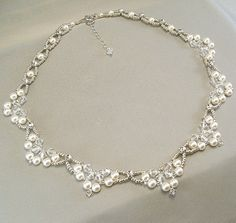 White Swarovski Pearls, Clear Swarovski Crystal and Clear Swarovski Diamante Rhinestones.  Silver seed beads are added for additional luster...