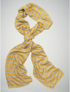 Since I can't pull off wearing a striped shirt, I love the idea of adding a striped scarf to my outfit instead!