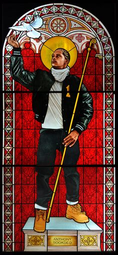 """Kehinde Wiley Puts a Classical Spin on His Contemporary Subjects - NYTimes.com Saint Remi"""" (2014), another stained-glass work."""