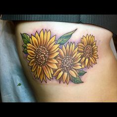 A trio of #sunflowers on the #ribs of @ginagiambatista from yesterday. Lots of fun with this! Thanks for looking. All done with the best: @heliostattoo #heliosproteam #heliosneedles @inkjecta #inkjectanano @dabtattoocream #dabtattoocreamproteam @trekow @tatu_chino @777tattoos #777tattoos #inkjectanano  @hivecaps @deathlesscords #deathlesscords #hivecaps @eikondevice @painfulpleasures @danlorenzock @kingpintattoosupply @skinandinkmag @inkedmag @yallzee @tattooartistmagazine #tattooartist…