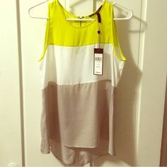 BCBGMAXAZRIA blouse NWT TOP. sleeveless slit quarter way up back. never worn. true to size. neon yellow, white and stone (gray) color blocked. NO TRADES. BCBGMaxAzria Tops Tank Tops