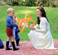 Catherine, Duchess of Cambridge plays with her children Princess Charlotte and Prince George at a children's party for Military families during the Royal Tour of Canada on September 29, 2016 in Victoria, Canada.