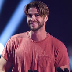 Pin for Later: Liam Hemsworth Sports a Smile After He Avoids Being Slimed — Twice!