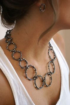 Designed by Megan Auman in 2010 and officially retired in 2013, the Cosmos collection featured silver droplets on a darkened silver base for a result that was both delicate and standout. Click here to shop Megan's current jewelry collections.