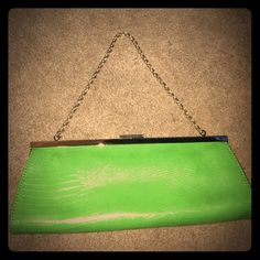 """NWT Loft clutch with snakeskin print This great purse converts from a clutch to a chain strap purse in minutes. The strap easily retracts into the purse to carry as a clutch. Purse is in great condition, never used.  Measurements 10 1/2"""" x 4 1/2"""" LOFT Bags Clutches & Wristlets"""