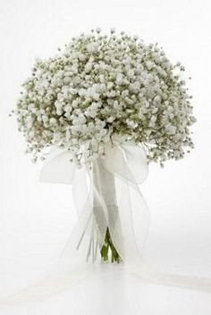 Gypsophila is back in fashion!! Love this single bloom bridal bouquet it has a dreamy, casual feel.