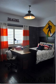 painted merete curtains from ikea. LOVE curtain idea & construction sign above bed.