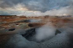 """Boiling Blue Mud.  """"Bubbling blue mud pots at the Hverir geothermal area in northern Iceland.""""  Photo by Sarah Marino."""