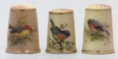 Fourteen English porcelain blush-ivory-ground thimbles; Late 19th century, puce printed marks to two; Comprising: two examples painted in the manner of Powell with birds, the remaining twelve similarly decorated, gilt-lined rims. Approx. 1 in. (2.5 cm.) high. Estimate: £700-1,000.