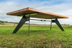 recycled timber and black metal dining table