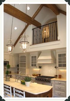 If we can't do the master suite in the roof, could we do something like this over the two upstairs bedrooms? Kitchen balcony loft over the two bedrooms?