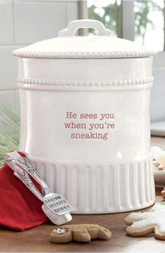 Bright, debossed 'He sees you when you're sneaking' lettering adds festive whimsy to a glossy ceramic jar perfect for stashing Christmas cookies. A shiny pair of tongs inscribed with 'Baking spirits bright' is included. Christmas Cookie Jars, Christmas Kitchen, Noel Christmas, Christmas Colors, Homemade Christmas, All Things Christmas, Christmas Themes, Christmas Crafts, Christmas Decorations