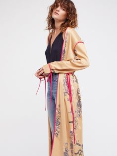 Slim Kimono Duster | Ultra slim printed duster in a long silhouette featuring a beautiful kimono-inspired design.    * Tie details at the sleeve cuffs * Contrast trims