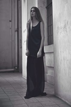 Alia B Pre-Fall 2014  Long singlet top in satin with organza trim at hem, worn with a sheer skirt.
