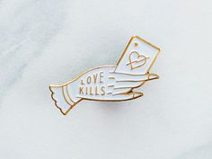 Made some pins. Available now in my shop.  Antique gold soft enamel pin - Butterfly clasp.  http://theblksmith.com/shop/love-kills-pin