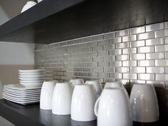Love the dark with the silver backsplash and how the white dishes pop against it. Contemporary | Kitchens | Barb Ince : Designer Portfolio : HGTV - Home & Garden Television