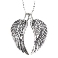 A gorgeous set of sterling silver angel wings hanging on a silver ball chain.These wonderful wings hang in a heart shape and will become a much loved necklace to whoever is lucky enough to receive them. The wings have been oxidised to give a slight blackened effect and therefore have a certain rock n roll edge to them. They have been amazingly popular with teenagers and anyone in their twenties, but there are no rules and and angel wing is such a classic symbol it can and has been worn by…