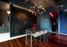 Turin Bachelor's Loft Interior by MG2 Architetture.   Love the light fixture.
