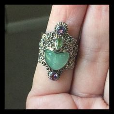 "Sajen Jade Face Goddess Jewel Ring Wow this ring is amazing!! Made by ""Sajen"" it has a genuine Jade face the crown has genuine amethysts and peridot stones. It is set in sterling silver. Very rare and unique Sajen Jewelry Rings"