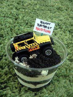 school birthday treat for my 7 yr. old son...individual cups of dirt cake with a Matchbox car on top  (car riding through a dirt road) for each child to take home.