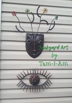 Junkyard Art by Tam-I-Am. Two of my favorite pieces. Repurposed scrap metal art. Shovel, garden rakes, pitch fork