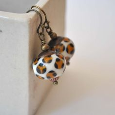 Leopard Print Earrings, Lampwork Glass Earrings, Brown White Earrings    These dainty brown earrings are made with artisan lampwork glass beads. The