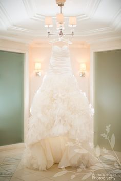 Anna and Spencer Photography, Atlanta wedding photographers. Bride's wedding dress hanging at the St. Regis in Buckhead Atlanta. Lazaro wedding dress from Bridals by Lori