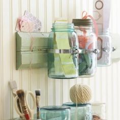 Hm, how about using an empty mason jar for a pencil/pen holder?