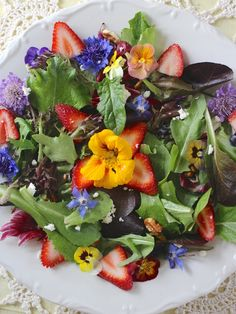Absolutely gorgeous salad with strawberries and edible flowers!  Sublime!!  What a beautiful idea for Springtime entertaining!