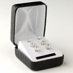 Dazzle your ears with these glamorous rhodium plated cz multi sized round cut stud earrings. These delightful earrings come in three different sizes with a stylish black leather snakeskin jewelry box included. Perfect accessory for your everyday wear or any special occasion.5mm, 6mm, 7mm