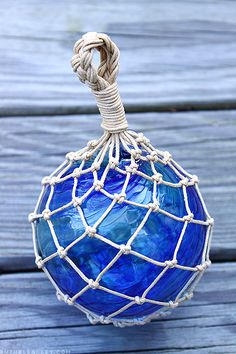 Hand-tied glass fishing float net - hand tied by @Ruth H. H. Bleakley, using a hand-blown glass ball made by @Bryan Boyer Boyer Boyer Randa