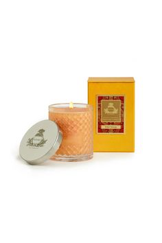 Bitter Orange Candle   Agraria's Crystal Candles are presented in a decorative crystal glass that is a modern interpretation of the woven palm leaf cases that were an Agraria trademark in the 1980s. The intricate glass pattern accentuates the movement of the flame to create a luminous and mesmerizing glow.     Each 7 oz/198 gram candle includes a sliver-plate lid stamped with the Agraria crest. Approximate burning time: 30-40 hours.  Bitter Orange Candle by Agraria. Home & Gifts - Home Decor…