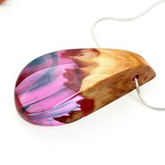 Pink/purple with swirls. Resin and wood pendant. .. .. . . #casting…