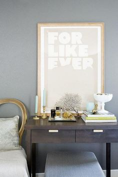 Here is a pretty vignette where the bedside table doubles as a vanity where you can store perfume and jewelry.