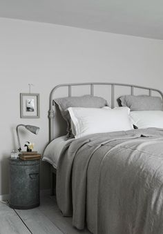 Grey bedding.  add purple sheets.
