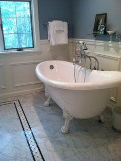 Traditional Bathroom Design, Pictures, Remodel, Decor and Ideas - page 19  I like the inlaid pattern in the floor plus the wainscot