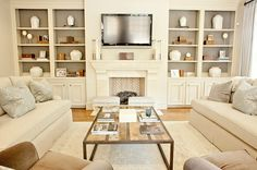Furniture set-up should you want to do two sofas facing each other, coffee table in middle, two chairs offset facing fireplace.  Artwork could hang on either side of the fireplace since you don't have bookshelves.
