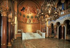 Pinterest. This is a picture of the Neuschwanstein Castle's throne room. It would be a very good location for the Queen of Hearts's palace.