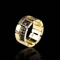 Cubism black diamond ring in in 18ct yellow gold.