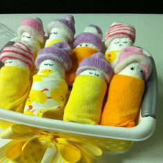 Diaper Babies - diaper, sock, wash cloth. Great way to present the typical diaper gifts at showers.
