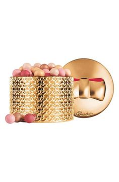 Guerlain Meteorites Perles d'Etoile and more iconic beauty products every woman should own.