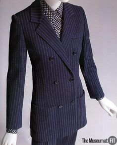 Navy wool pinstripe suit by Yves Saint Laurent (1967) via The FIT Museum