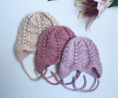 """The hat is worked bottom up. Please note that the different sizes have a slightly different look. The size 0-1 months and 18-24 months has one """"point"""" down the forehead while size 6-12 months has two."""