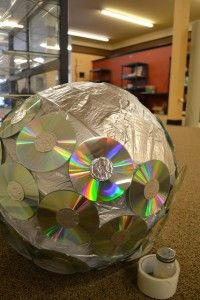 Old cd roms to make a disco ball on styrofoam