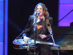 One happy chick. The Dixie Chicks' Emily Robison is delighted to be onstage during a performance on Oct. 26 in Vancouver, British Columbia