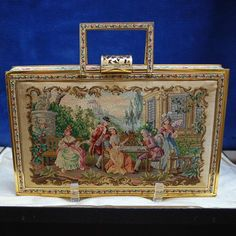 Two Pattern Figural  Petit Point Purse Vanity Bag Compact Hard Case. Beautiful two sided petit point purse with fine details of period figures partaking in a number of activities. On the front we see a couple playing cards, another couple watching the game while a woman sits on a nearby bench, possibly waiting for her suitor to show. On the backside, a woman is seated with a maidservant.