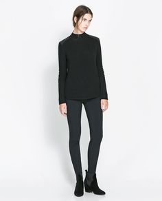Image 1 of SWEATER WITH FAUX LEATHER APPLIQUÉS from Zara
