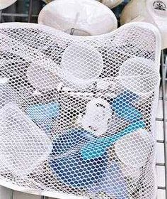 Use a laundry bag to keep lids and smaller items in check.   37 Hacks To Make Dish Washing Easier